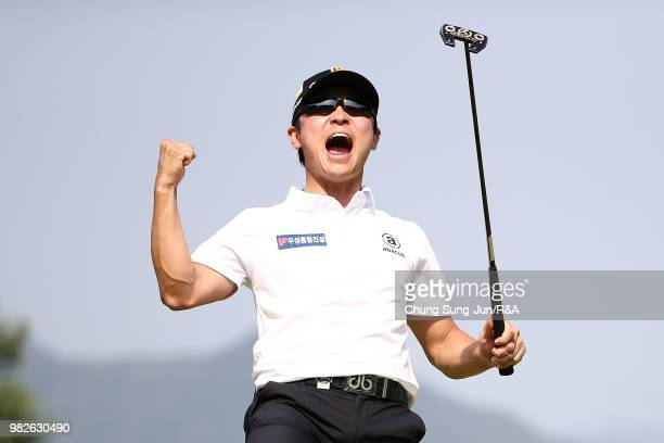 Choi MinChul of South Korea lifts the Championship's trophy during a ceremony following the final round of the Kolon Korea Open Golf Championship at...