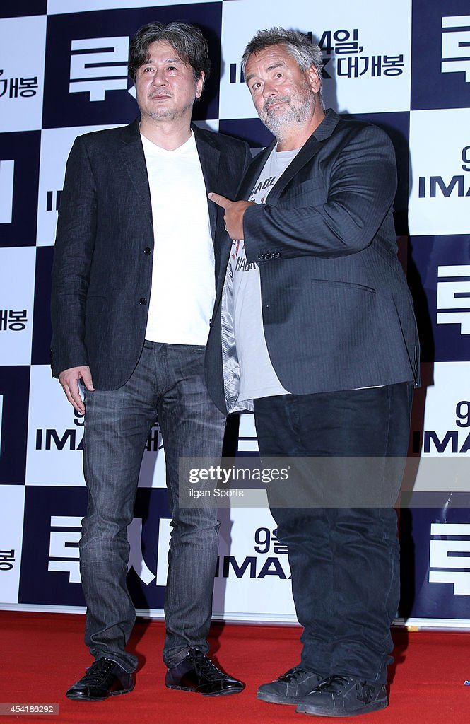 Choi Min-Sik and Luc Besson pose for photographs during the movie 'LUCY' red carpet event at IFC mall on August 20, 2014 in Seoul, South Korea.