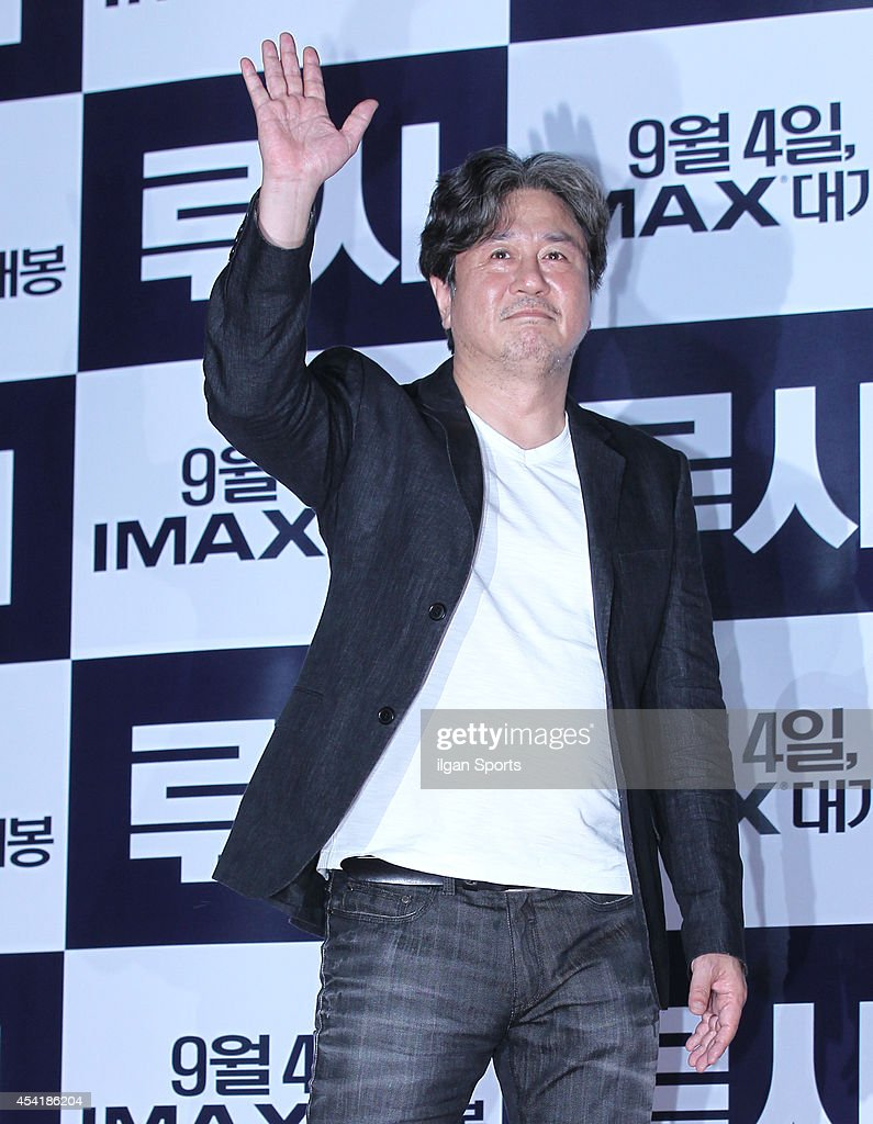 Choi Min-Sik poses for photographs during the movie 'LUCY' red carpet event at IFC mall on August 20, 2014 in Seoul, South Korea.
