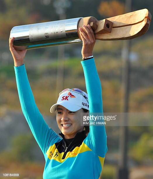 Choi NaYeon of South Korea raises her trophy for the media after winning the LPGA Hana Bank Championship golf tournament at Sky72 Golf Club Ocean...