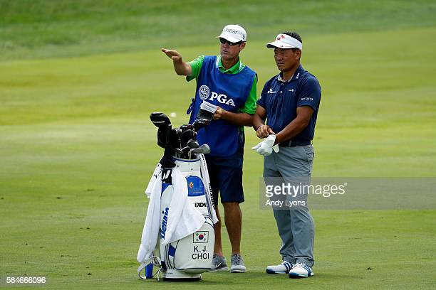 J Choi of Korea and caddie Don Donatello wait on a fairway during the second round of the 2016 PGA Championship at Baltusrol Golf Club on July 29...