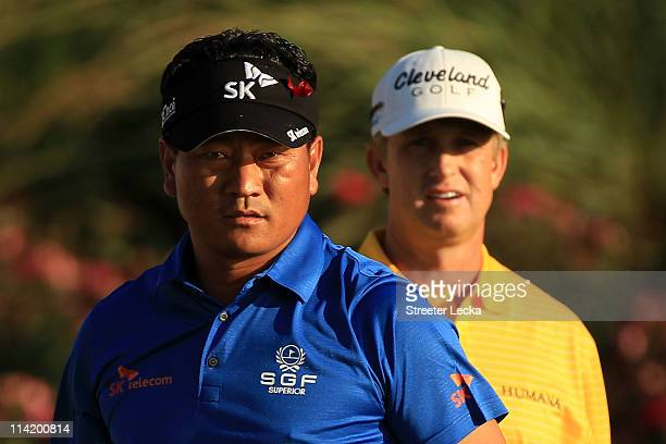 Choi of South Korea and David Toms look on from the 18th tee box during the final round of THE PLAYERS Championship held at THE PLAYERS Stadium...