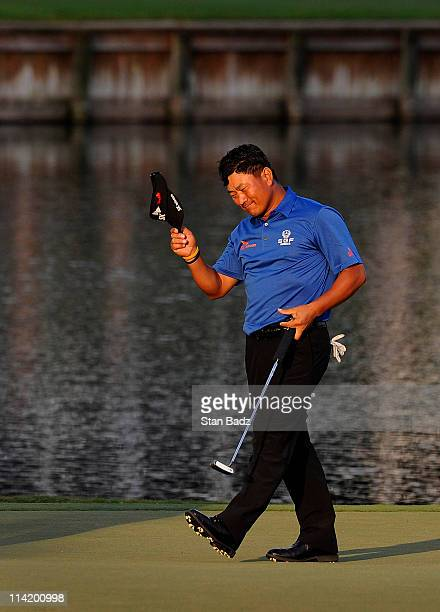 J Choi of South Korea celebrates after making a parsaving putt to defeat David Toms on the first playoff hole during the final round of THE PLAYERS...