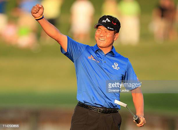 Choi of South Korea celebrates making a par-saving putt to defeat David Toms on the first playoff hole during the final round of THE PLAYERS...