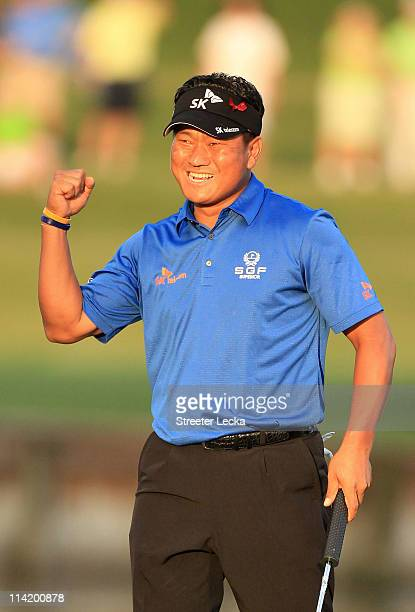 J Choi of South Korea celebrates making a parsaving putt to defeat David Toms on the first playoff hole during the final round of THE PLAYERS...