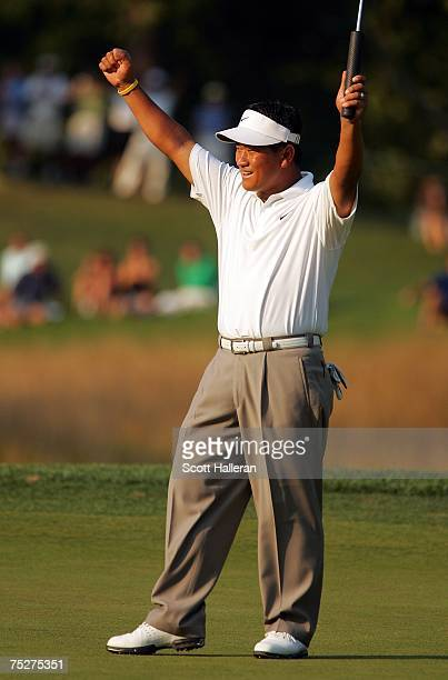 J Choi of South Korea celebrates on the 18th green after his threestroke victory at the ATT National at Congressional Country Club on July 8 2007 in...