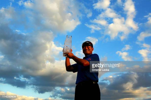 J Choi of South Korea celebrates with the trophy after defeating David Toms on the first playoff hole during the final round of THE PLAYERS...