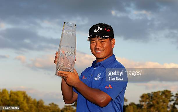 Choi of South Korea celebrates with the trophy after defeating David Toms on the first playoff hole during the final round of THE PLAYERS...