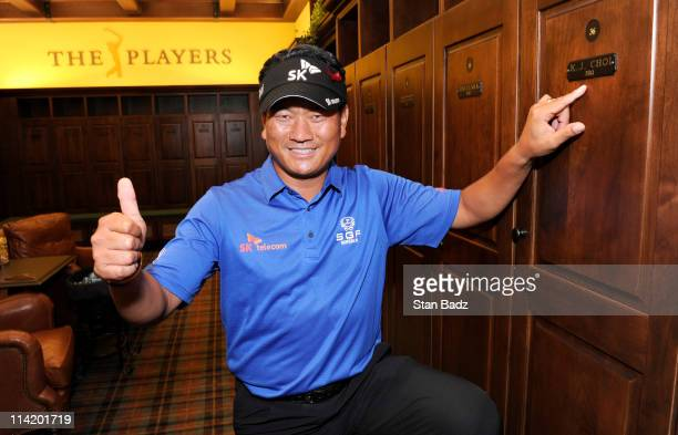 J Choi of South Korea gives a thumbs up next to his new locker in the Champions locker room after the final round of THE PLAYERS Championship on THE...