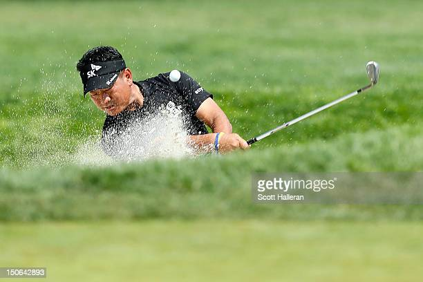 J Choi of South Korea hits a shot out of the bunker on the ninth hole during the First Round of The Barclays on the Black Course at Bethpage State...