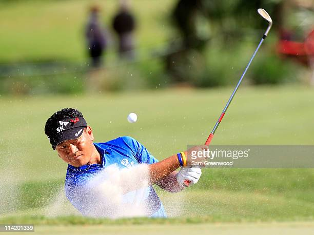 J Choi of South Korea hits from a bunker on the 12th hole during the final round of THE PLAYERS Championship held at THE PLAYERS Stadium course at...