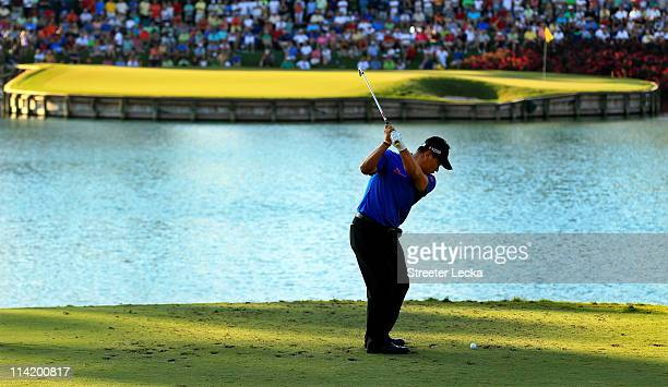 J Choi of South Korea hits his tee shot on the 17th hole during the final round of THE PLAYERS Championship held at THE PLAYERS Stadium course at TPC...