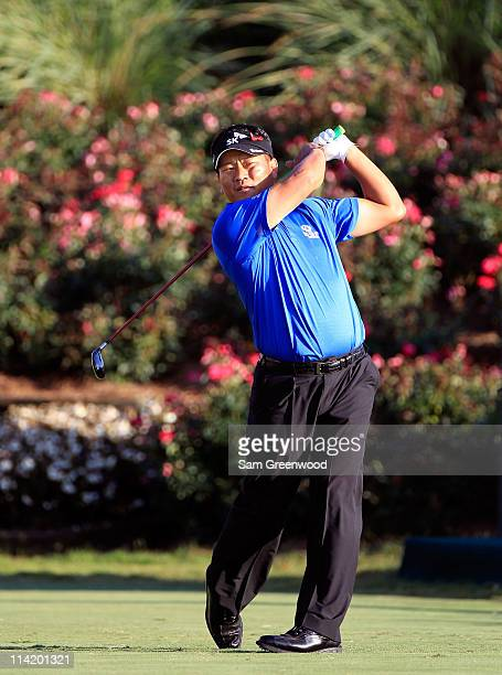 J Choi of South Korea hits his tee shot on the 18th hole during the final round of THE PLAYERS Championship held at THE PLAYERS Stadium course at TPC...