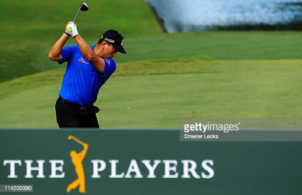 J Choi of South Korea hits his tee shot on the tenth hole during the final round of THE PLAYERS Championship held at THE PLAYERS Stadium course at...