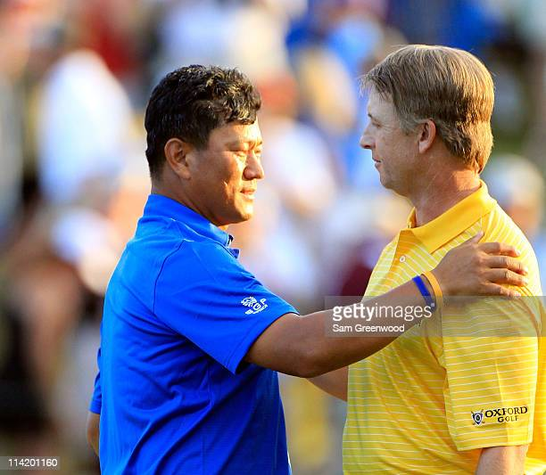 KJ Choi of South Korea hugs David Toms after defeating him on the first playoff hole to win THE PLAYERS Championship held at THE PLAYERS Stadium...