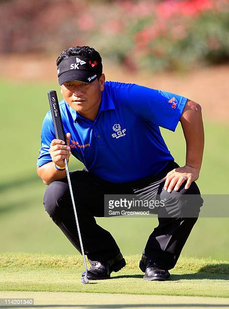 J Choi of South Korea lines up a putt on the 14th hole during the final round of THE PLAYERS Championship held at THE PLAYERS Stadium course at TPC...