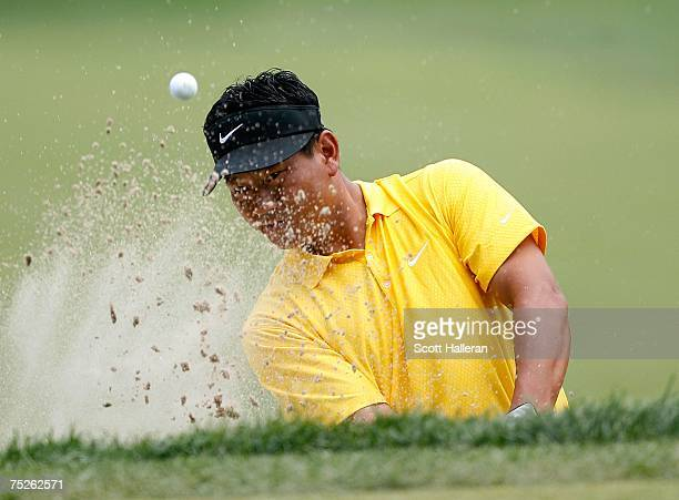 J Choi of South Korea plays a bunker shot on the first hole during the third round of the ATT National at Congressional Country Club on July 7 2007...