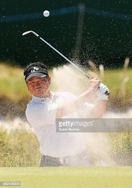 Choi of South Korea plays out of the bunker during practice ahead of the World Cup Of Golf at Royal Melbourne Golf Course on November 19, 2013 in...