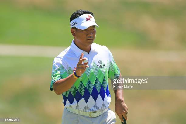 J Choi of South Korea waves to the crowd on the eighth hole during the second round of the ATT National at Aronimink Golf Club on July 1 2011 in...
