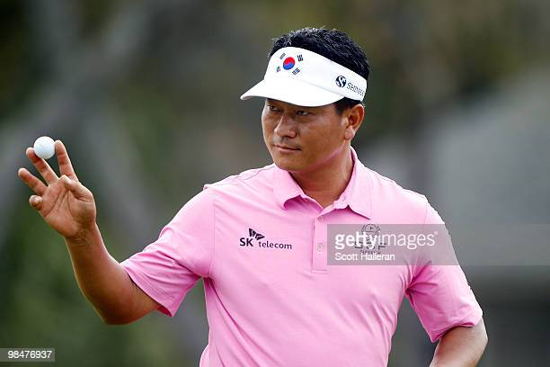 J Choi of South Korea waves to the gallery on the 17th hole during the first round of the Verizon Heritage at the Harbour Town Golf Links on April 15...