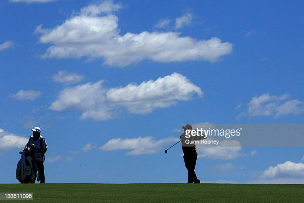 J Choi of the International Team plays his second shot on the second hole during the Day Four Singles Matches of the 2011 Presidents Cup at Royal...