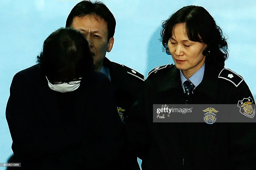 Choi Soon-Sil, a confidant of South Korean President Park Geun-Hye, is to get on a bus of Ministry of Justice as she leaves the Seoul Central District Court on November 3, 2016 in Seoul, South Korea. The prosecutors was issued an arrest warrant for Choi Soon-sil for allegedly influencing state affairs and embezzling money by taking advantage of her close relationship with President Park Geun-hye.