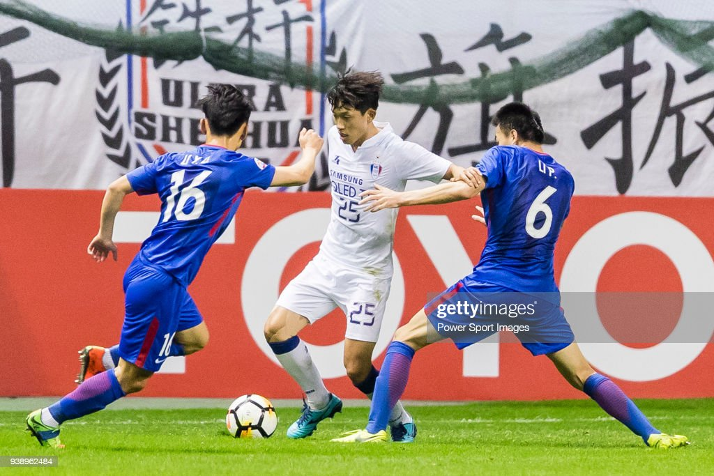 Choi Sung-Kuen of Suwon Samsung Bluewings (C) fights for the ball with Li Yunqiu of Shanghai Shenhua FC (L) and Li Peng of Shanghai Shenhua FC (R) during the AFC Champions League 2018 Group H match between Shanghai Shenhua (CHN) vs Suwon Samsung Bluewings (KOR) at Hongkou Stadium on 13 March 2018, in Shanghai, China.