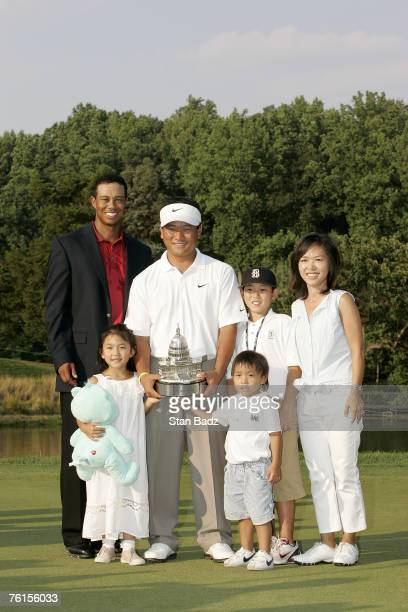 KJ Choi with Tiger Woods and family after the fourth and final round of the ATT National held at Congressional Country Club in Bethesda Maryland on...