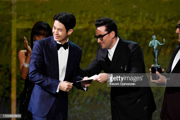 Choi Wooshik accepts Outstanding Performance by a Cast in a Motion Picture for 'Parasite' from Dan Levy onstage during the 26th Annual Screen...
