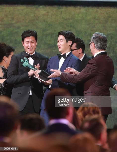 Choi Wooshik and Lee Sun Gyun accept Outstanding Performance by a Cast in a Motion Picture for 'Parasite' onstage during the 26th Annual Screen...