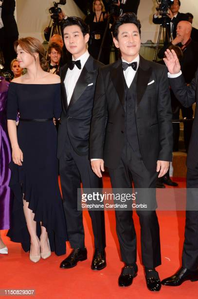 Choi WooShik and Lee SunKyun attends the screening of Parasite during the 72nd annual Cannes Film Festival on May 21 2019 in Cannes France