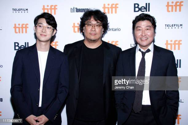 """Choi Woo-shik, Bong Joon-ho and Song Kang-Ho attend the """"Parasite"""" premiere during the 2019 Toronto International Film Festival at Ryerson Theatre on..."""