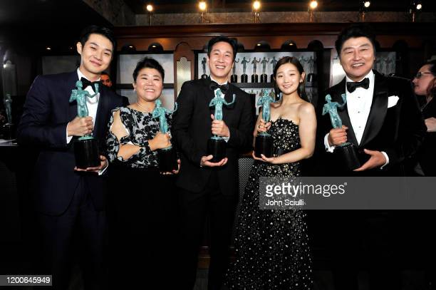 Choi Wooshik Lee Jeongeun Lee Sun Gyun Sodam Park and Kangho Song winners of the Outstanding Performance by a Cast in a Motion Picture award for...
