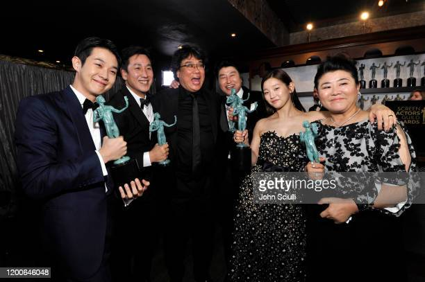Choi Woo-shik, Lee Sun Gyun, Bong Joon-ho, Song Kang Ho, Park So-dam, and Jeong-eun Lee winners of Outstanding Performance by a Cast in a Motion...