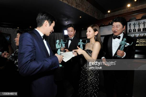Choi Wooshik Lee Sun Kyun Park Sodam and Song Kang Ho winners of Outstanding Performance by a Cast in a Motion Picture for 'Parasite' are seen in the...