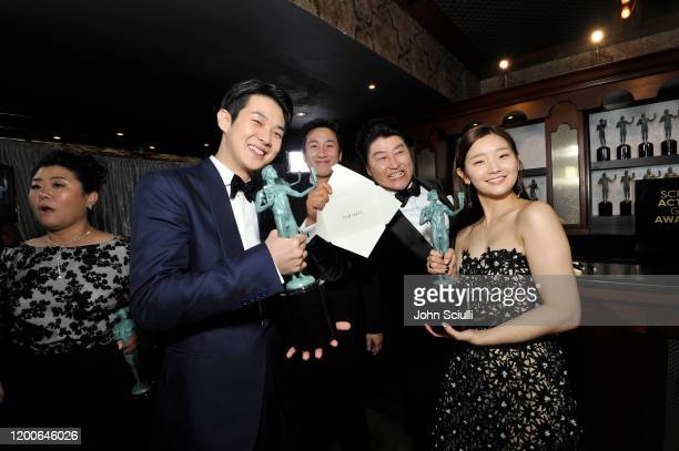 Choi Wooshik Lee Sun Kyun Song Kang Ho and Park Sodam winners of Outstanding Performance by a Cast in a Motion Picture for 'Parasite' pose in the...