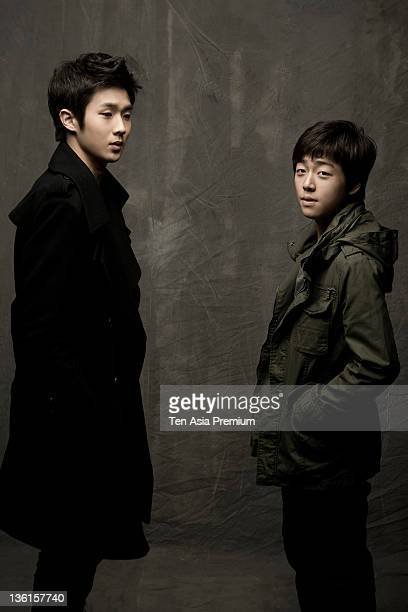 Choi WooSi and Noh YoungHak pose for photographs on March 11 2011 in Seoul South Korea