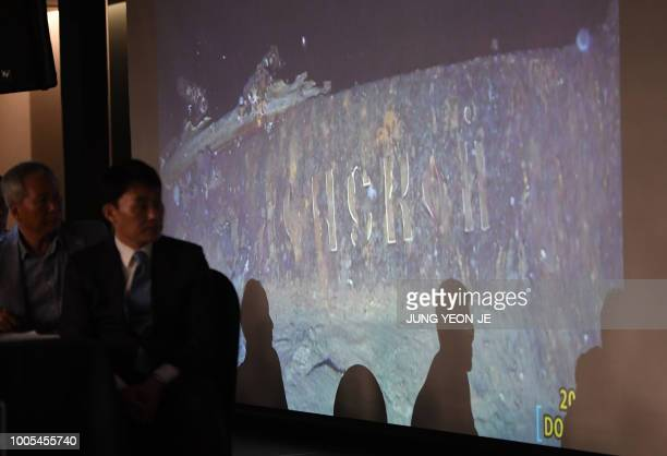 Choi Yongseok CEO of Shinil Group looks at a video footage taken by a submersible of the wreck with the word 'Donskoi' visible on the hull during a...