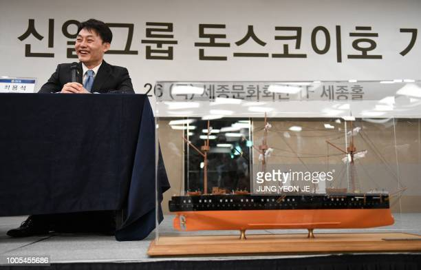 Choi Yongseok CEO of Shinil Group speaks during a press conference on a Russian 'treasure' ship in Seoul on July 26 2018 as a scale model of Imperial...