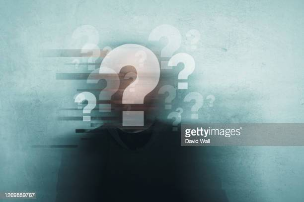 choice, confusion and mental health concept. a mans head covered in question marks with a blurred, grunge, abstract edit - asking stock pictures, royalty-free photos & images