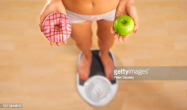 choice of good food or bad food - unhealthy eating stock pictures, royalty-free photos & images