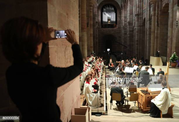 A choir and orchestra prepare prior to a requiem for former German Chancellor Helmut Kohl at the Speyer cathedral on July 1 2017 in Speyer Germany...