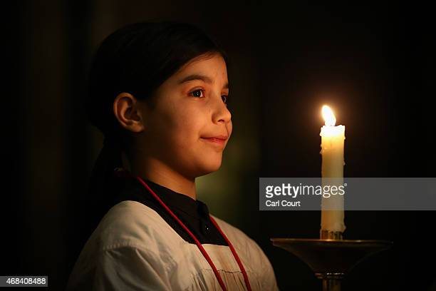 A choir girl waits to form a ceremonial procession following a Maundy service led by Cardinal Vincent Nichols at Westminster Cathedral on April 2...