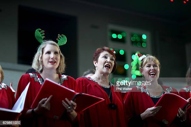 A choir group sings Christmas carols on Franklin Road on December 14 2016 in Auckland New Zealand It is the 23rd year Franklin Road residents have...