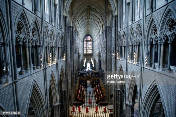 Choir members sing at Westminster Abbey on August 16, 2020 in London, England. Six members of the Westminster Abbey were allowed back to sing at the...