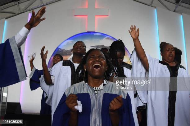 Choir members sing during the Sunday mass without wearing masks and social distancing at Ufunuo na Uzima Church in Dar es Salaam on February 7, 2021....