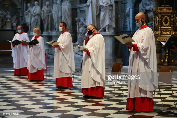 Choir members wear face masks as they sing at Westminster Abbey on August 16, 2020 in London, England. Six members of the Westminster Abbey were...