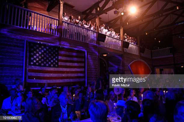 A choir performs above the audience during Apollo in the Hamptons 2018 Hosted by Ronald O Perelman at The Creeks on August 11 2018 in East Hampton...