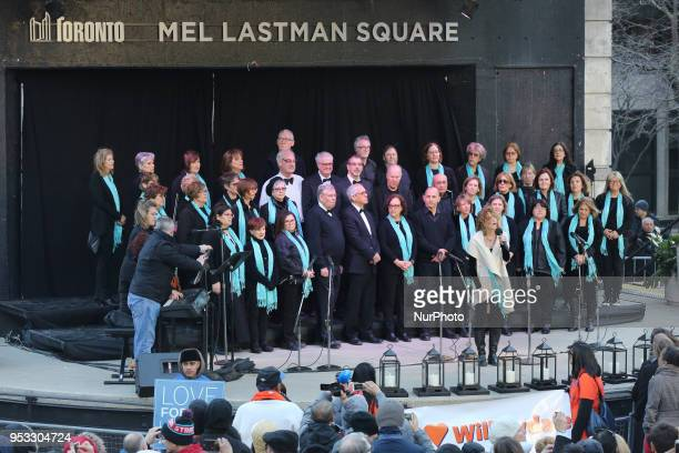 Choir performs as thousands of people attended an interfaith vigil at Nathan Phillips Square in memory of the 10 people killed and 15 people injured...