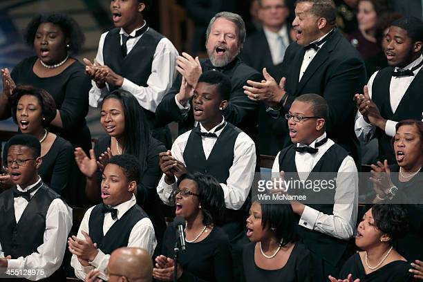 A choir performs during a memorial service for former South African President Nelson Mandela at the Washington National Cathedral December 11 2013 in...